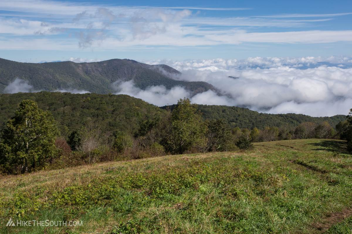 Clouds roll through the mountains as you relax on top of Siler Bald.