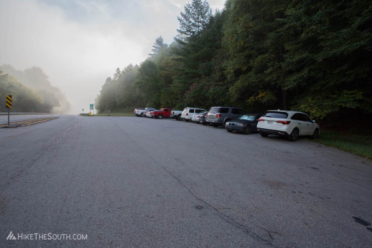 Foggy morning at the Winding Stair Gap trailhead. There's 13 marked parking spots and a few more cars can squeeze in around the sides.